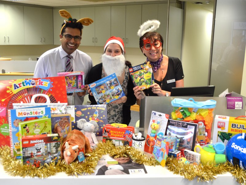 Hinckley & Rugby staff put Christmas toys on the table