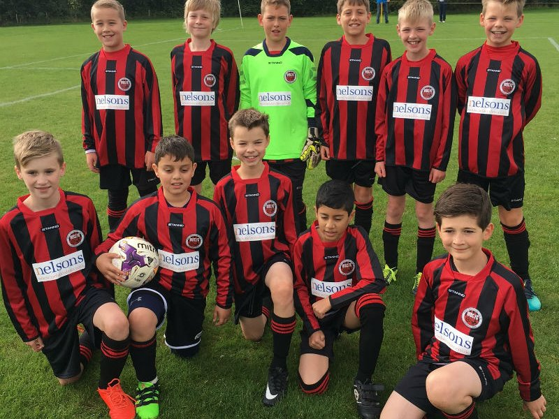 YOUTH FOOTBALL TEAM SCORES NEW KIT THANKS TO LAW FIRM
