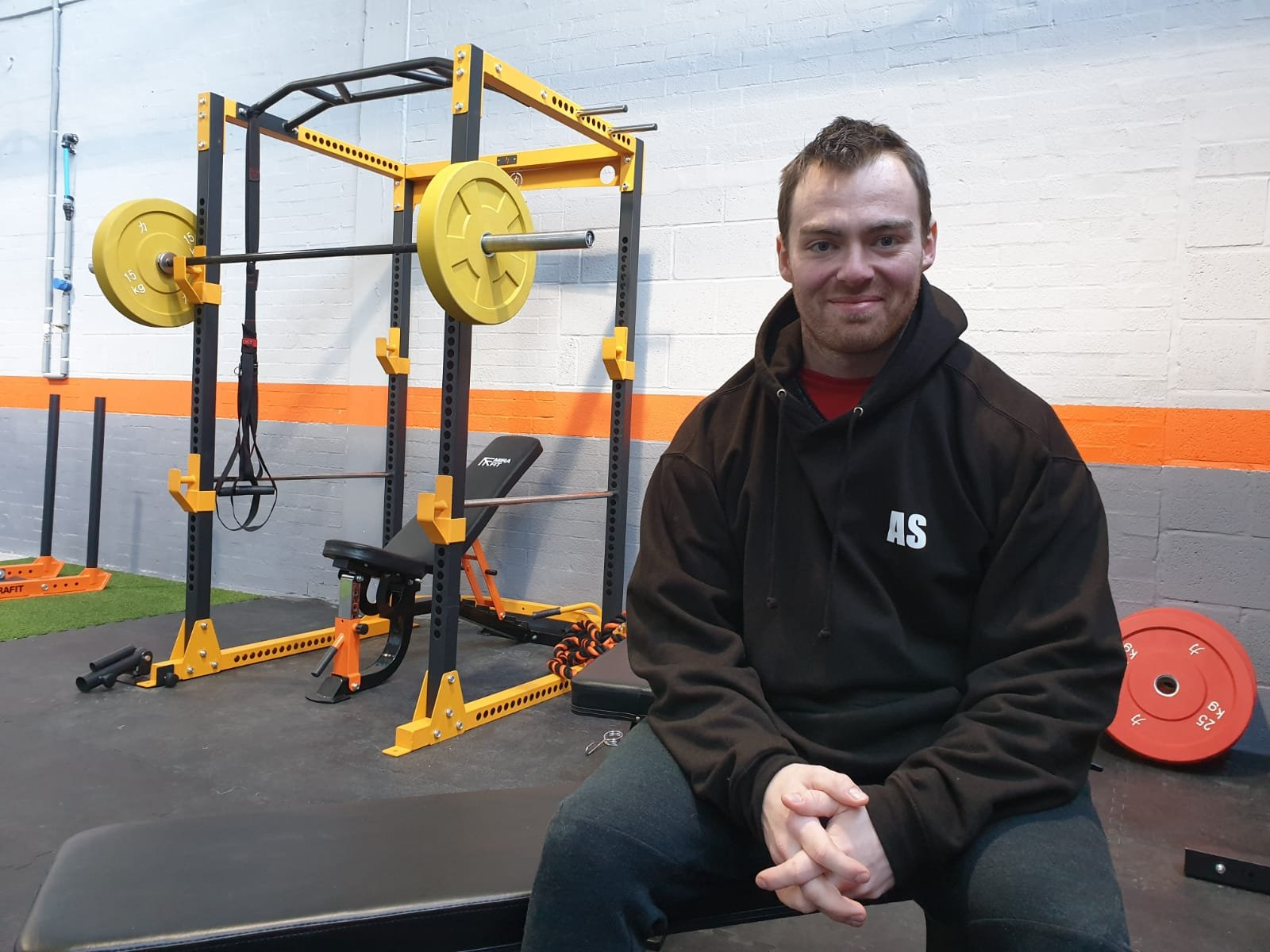 Former Notts international powerlifter who cheated death after being impaled on a fence following horrific car accident opens his first gym