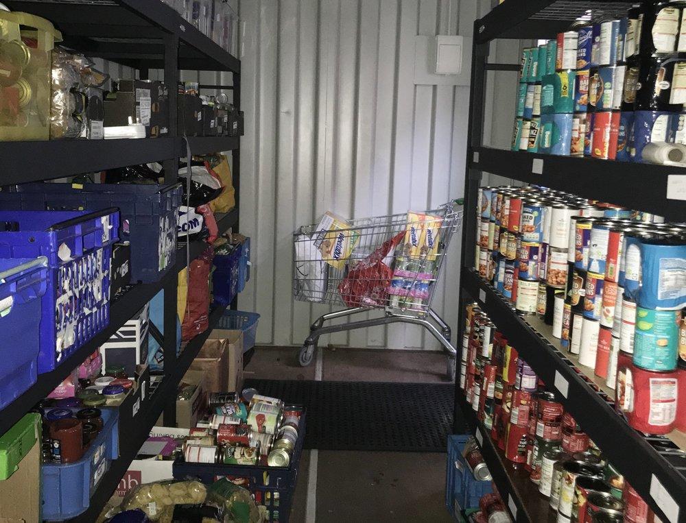 Dains Burton office raise money for local YMCA foodbank