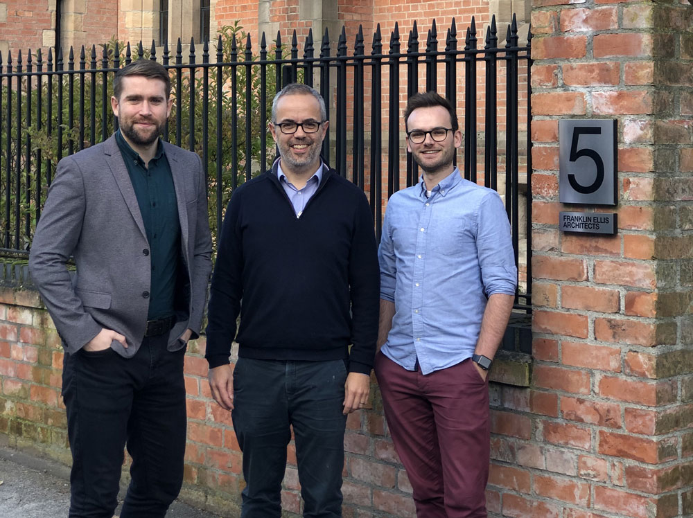 Team members celebrate official qualification at Franklin Ellis Architects