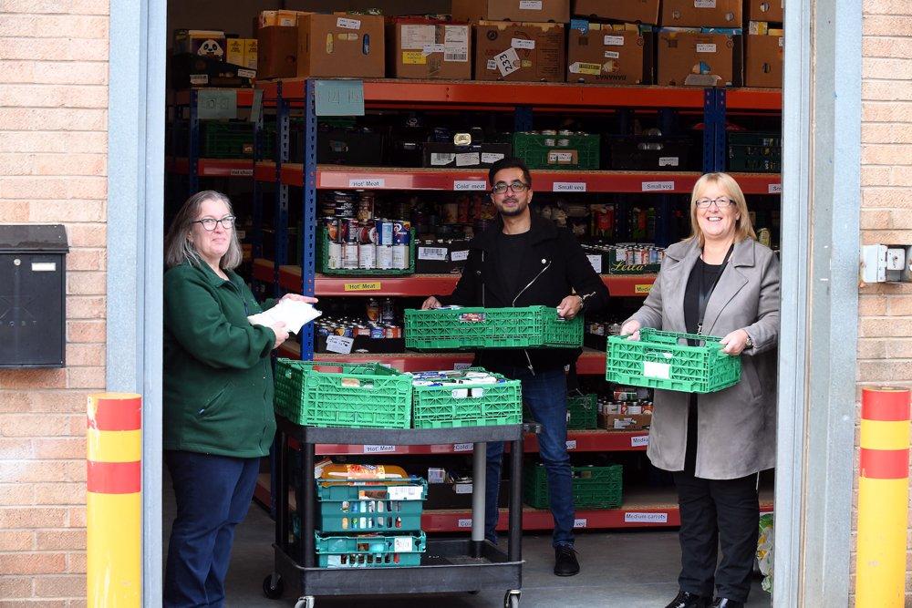 Retailer's four-figure donation to Hinckley food bank