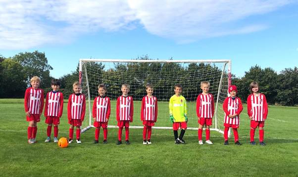 Thompsons United FC U7s Flames team with brand-new Mulberry kit